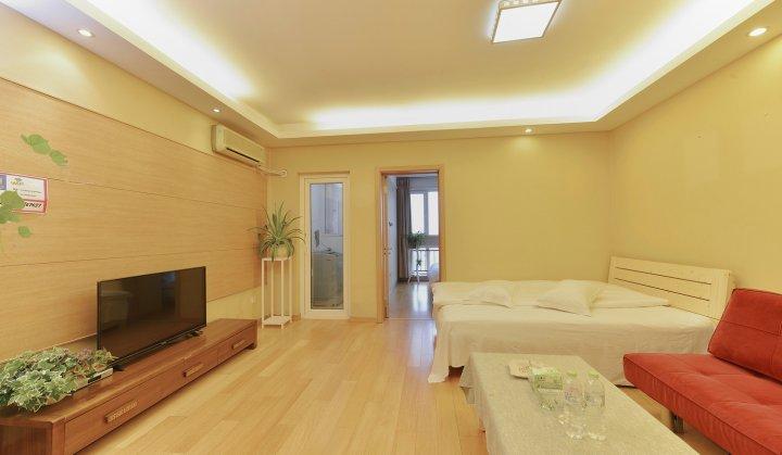 青岛暖爱色彩公寓
