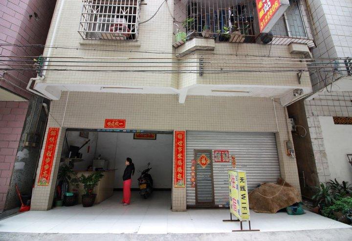 四会渝港湾旅店