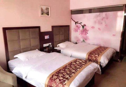 新平樱花假日酒店